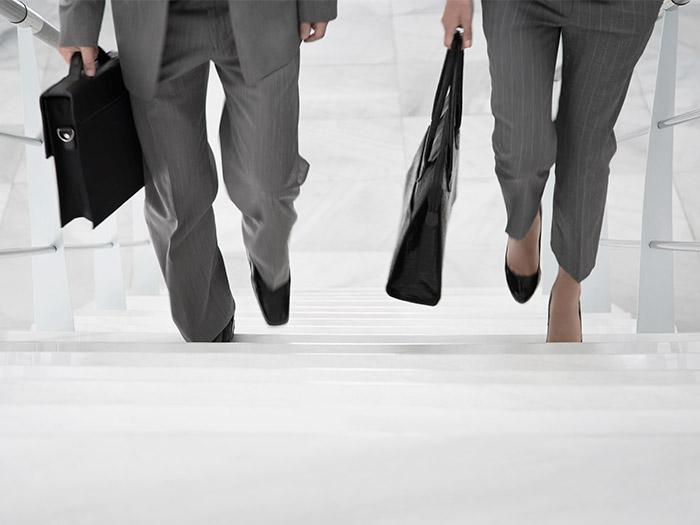 Business people walking up stairs   Atradius