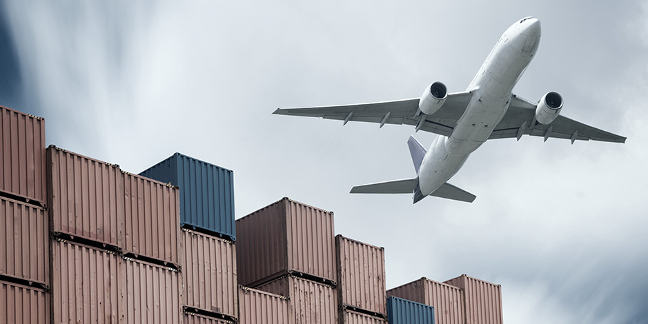 Airplane flying over containers