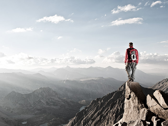 Man standing on a mountain | Atradius
